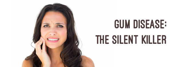 woman with long dark hair holding her jaw in front a white background next to the text 'gum disease: the silent killer'