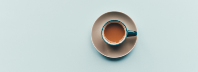 Overhead illustration of a cup of coffee on top of a plate with a light blue background