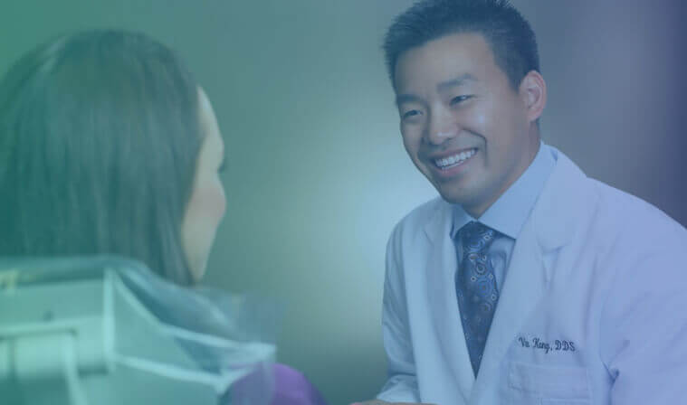 Dr. Vu Kong assisting a female patient