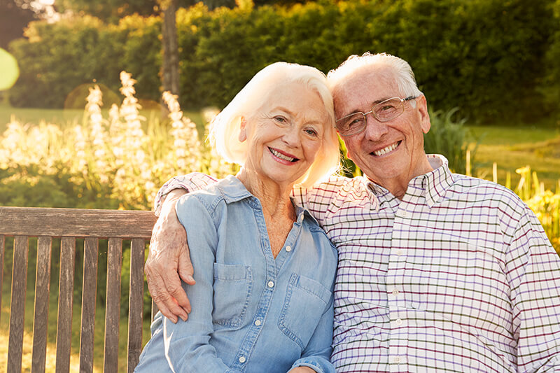 Elderly man and woman with dentures