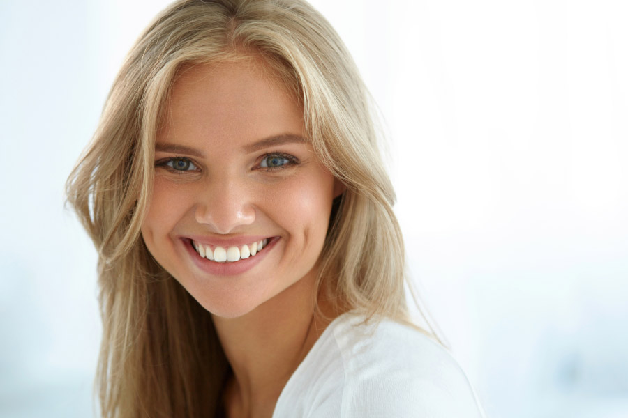 young woman with a dazzling straight smile