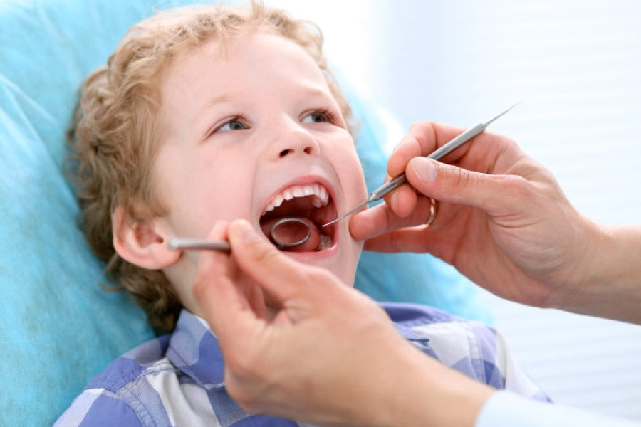 young boy getting a dental exam after overcoming his anxiety